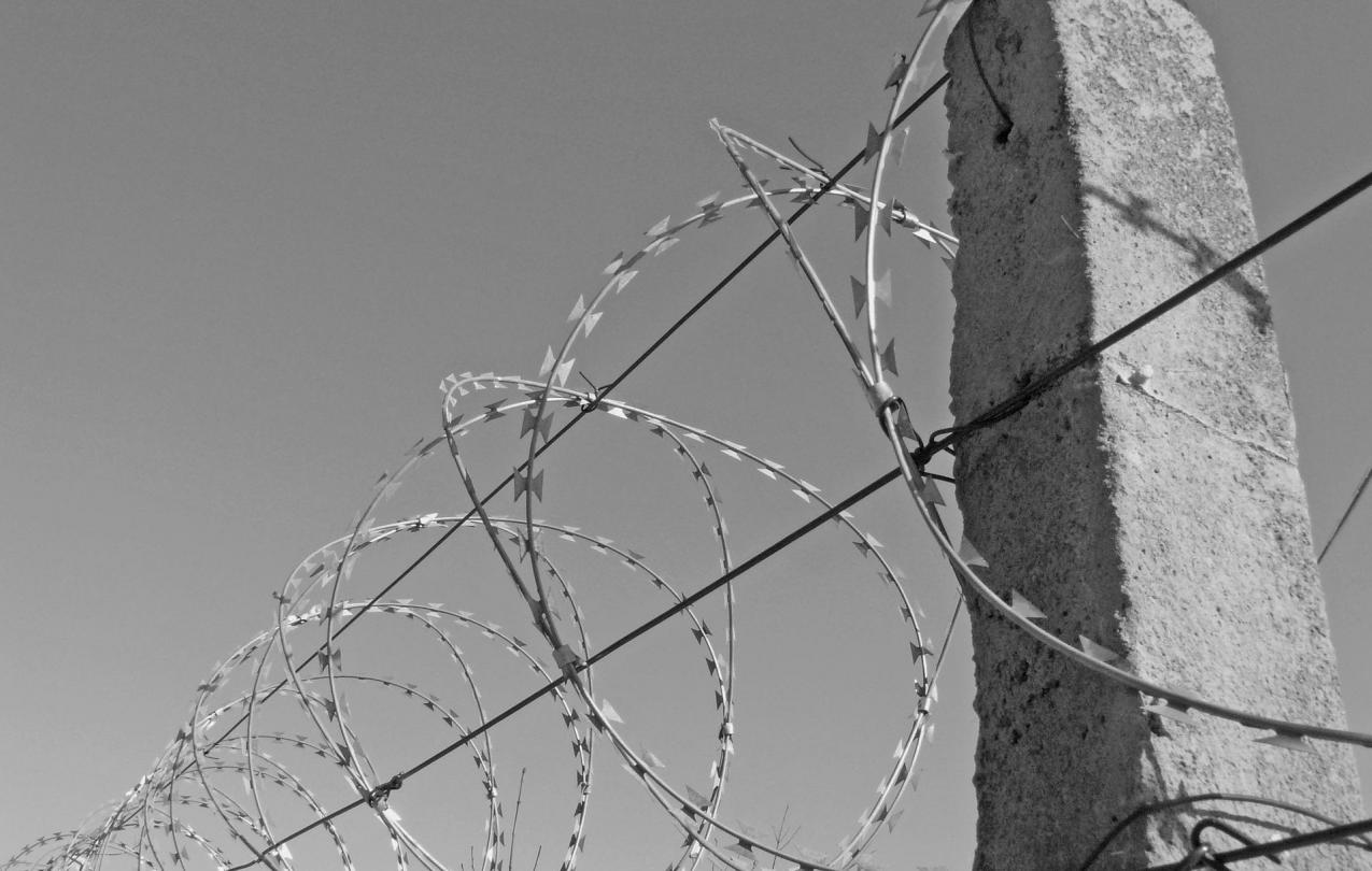 photo of barbed wire outside a prison